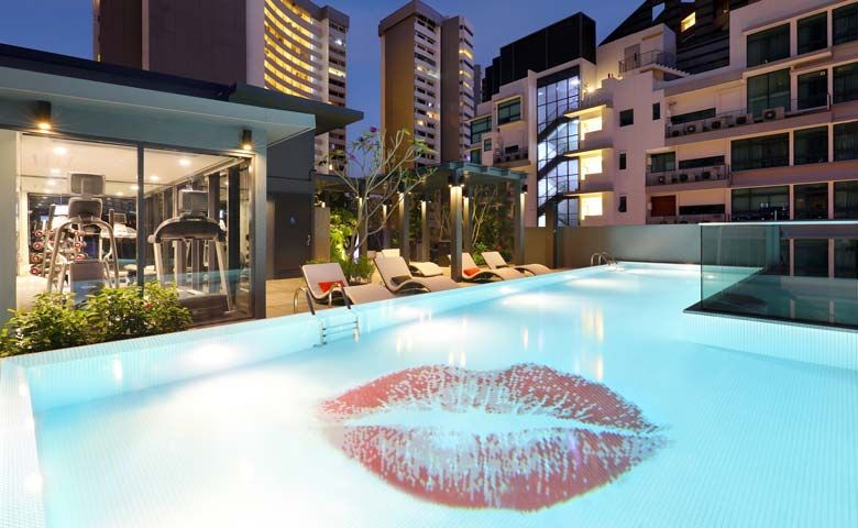 Oakwood Studios Singapore's rooftop pool and BBQ area
