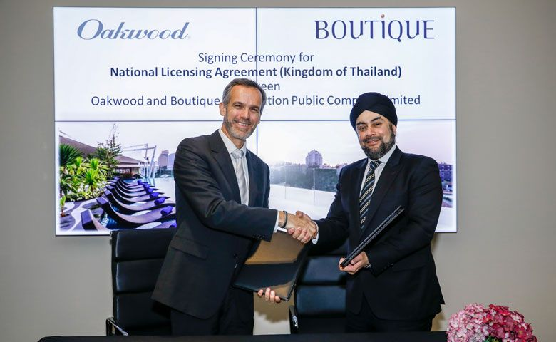 Signing Ceremony between Dean Schreiber, managing director, Asia Pacific, Oakwood (left) and Prab Thakral, president and group CEO, Boutique Corporation Public Company Limited (right)