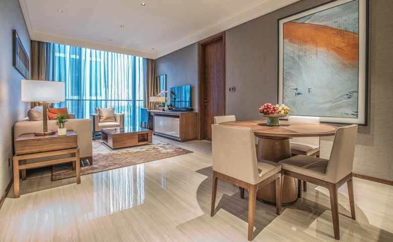 Oakwood Residence Damei Beijing's apartment living room and kitchen