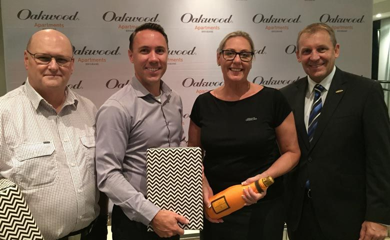 Pictured in photo (from left): Pilots Steve Scarr and Shane Hunter, Annette DeSimoni of Corporate Traveller, Paul Wilsher – General Manager, Oakwood Apartments Brisbane