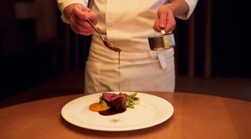 Relax and indulge in a private chef dining experience in the comfort of your apartment.