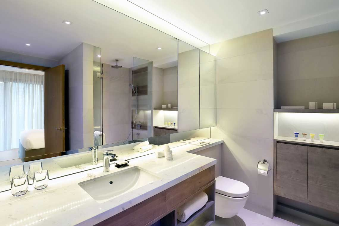 Oakwood Studios Singapore's one-bedroom deluxe apartment's bathroom