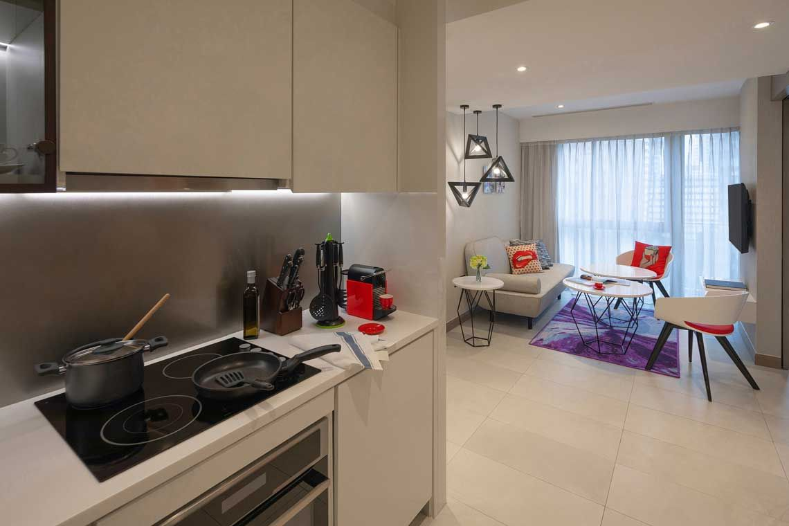 Oakwood Studios Singapore's two-bedroom family deluxe apartment's kitchen and living room