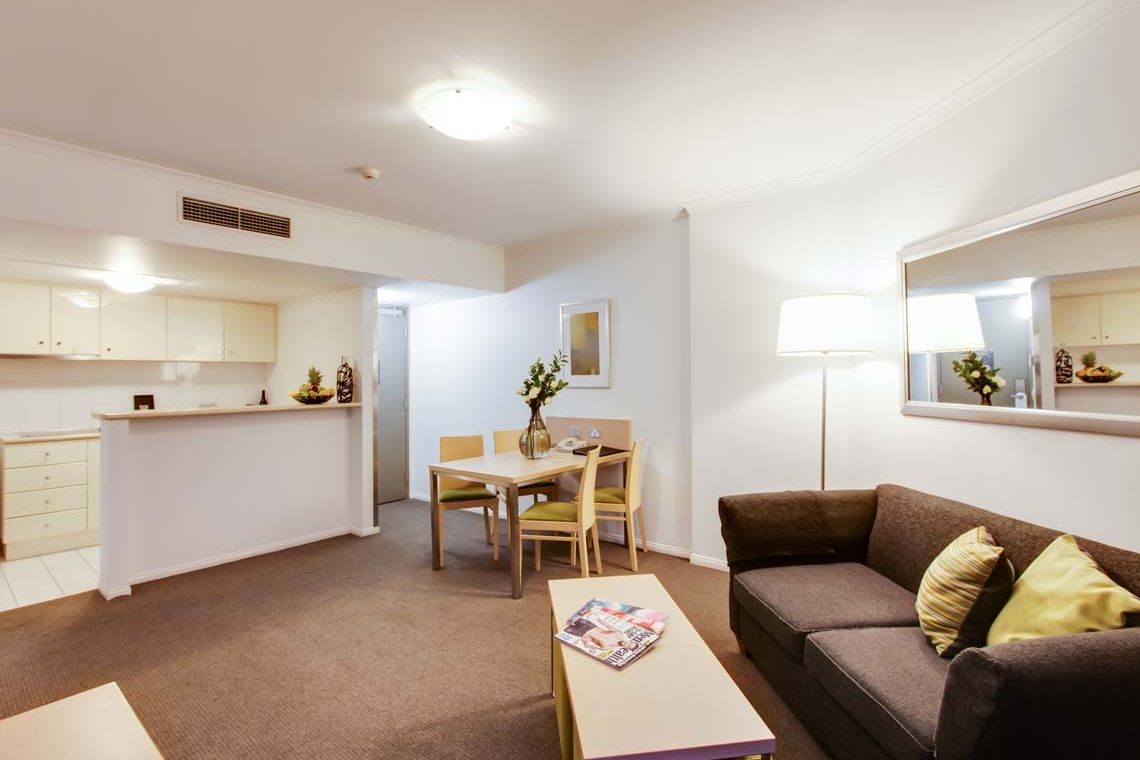 Oakwood Hotel & Apartments Brisbane one-bedroom superior apartment's living room