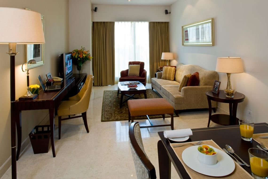 Oakwood Premier Prestige Bangalore's one-bedroom superior apartment's living room