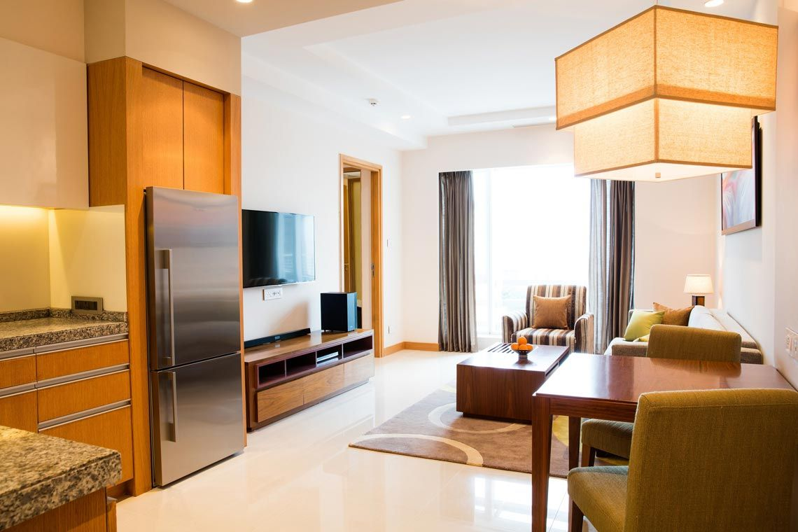 Oakwood Residence Kapil Hyderabad's one-bedroom deluxe apartment's living room