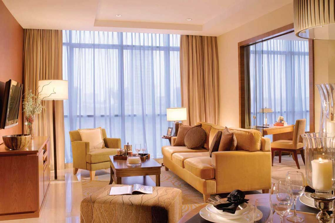 Oakwood Premier Cozmo Jakarta's one-bedroom executive king apartment's living room