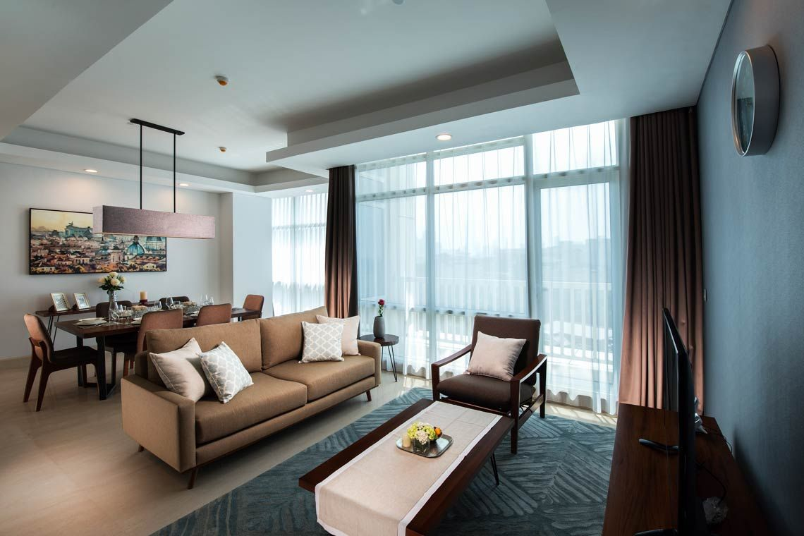 Oakwood Suites La Maison Jakarta's three-bedroom executive apartment's living room