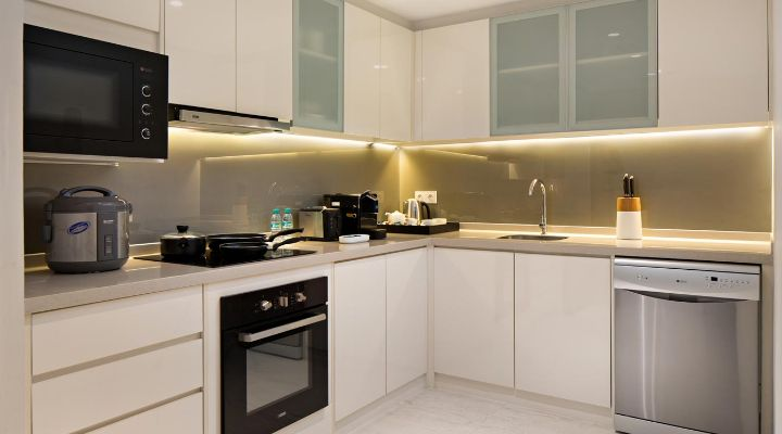 Oakwood Hotel & Residence Surabaya's two-bedroom apartment's kitchen