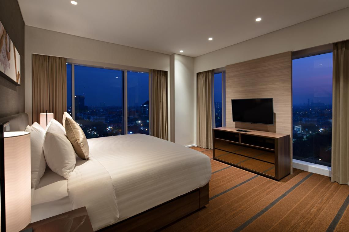 Oakwood Hotel & Residence Surabaya's two-bedroom deluxe apartment's master bedroom