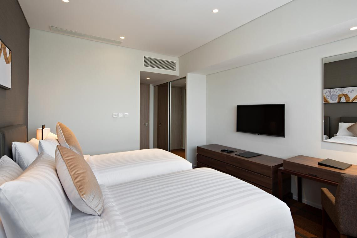 Oakwood Hotel & Residence Surabaya's two-bedroom deluxe apartment's second bedroom