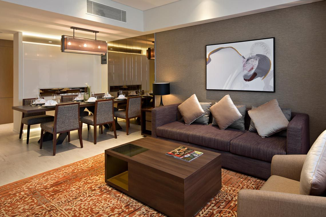 Oakwood Hotel & Residence Surabaya's two-bedroom deluxe apartment's living room