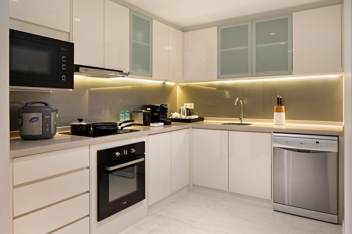 Oakwood Hotel & Residence Surabaya's two-bedroom deluxe apartment's kitchen
