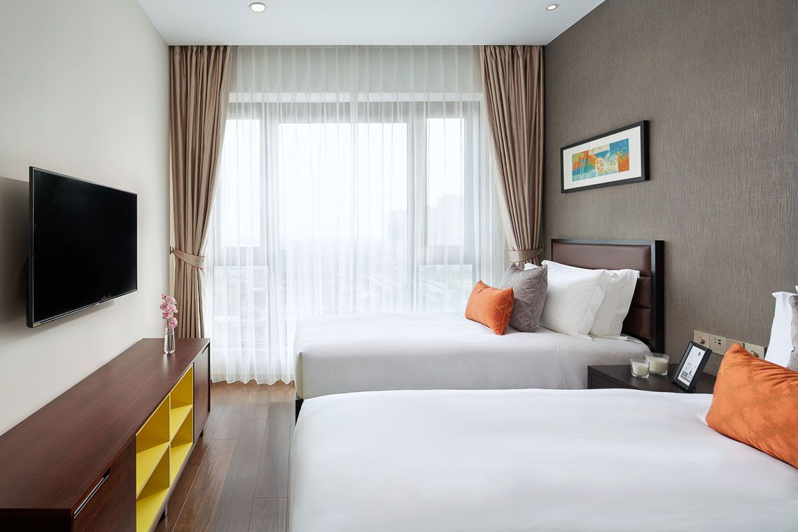 Oakwood Apartments Yangzhou's three-bedroom deluxe apartment twin bed