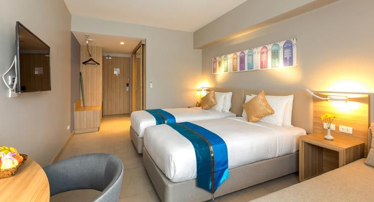 Deluxe Rooms at Oakwood Hotel Journeyhub Phuket are well appointed with travel essentials