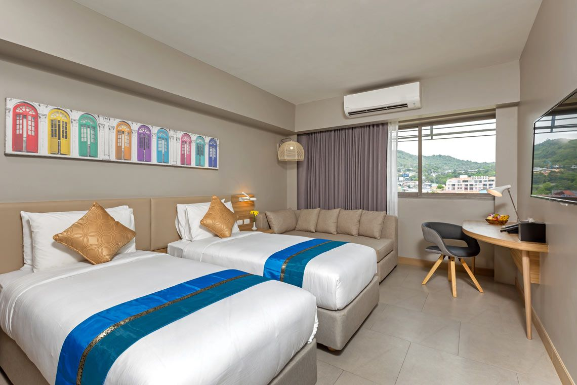 Oakwood Hotel Journeyhub Phuket's premier corner mountain view room