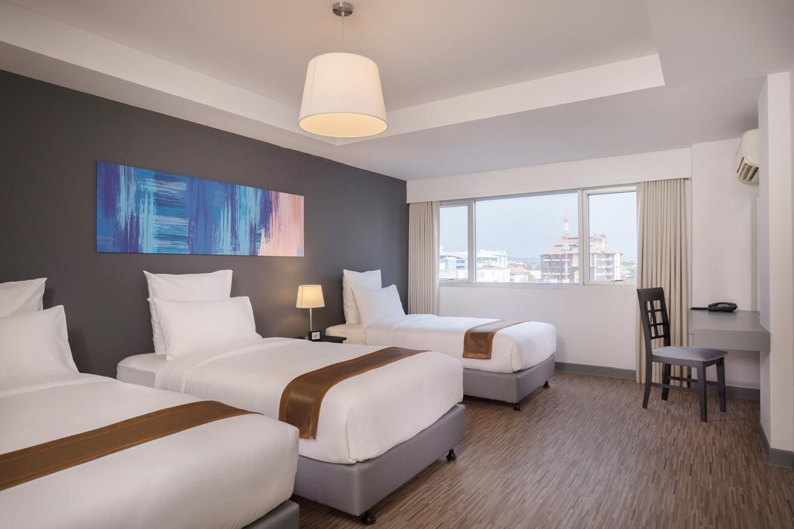 Oakwood Hotel Journeyhub Pattaya's two-bedroom family suite beds