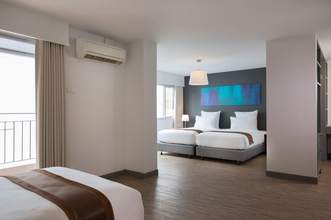 Oakwood Hotel Journeyhub Pattaya's two-bedroom family suite layout
