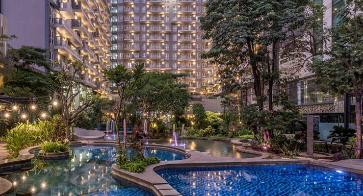 Oakwood Residence Cikarang's lush gardens and pool