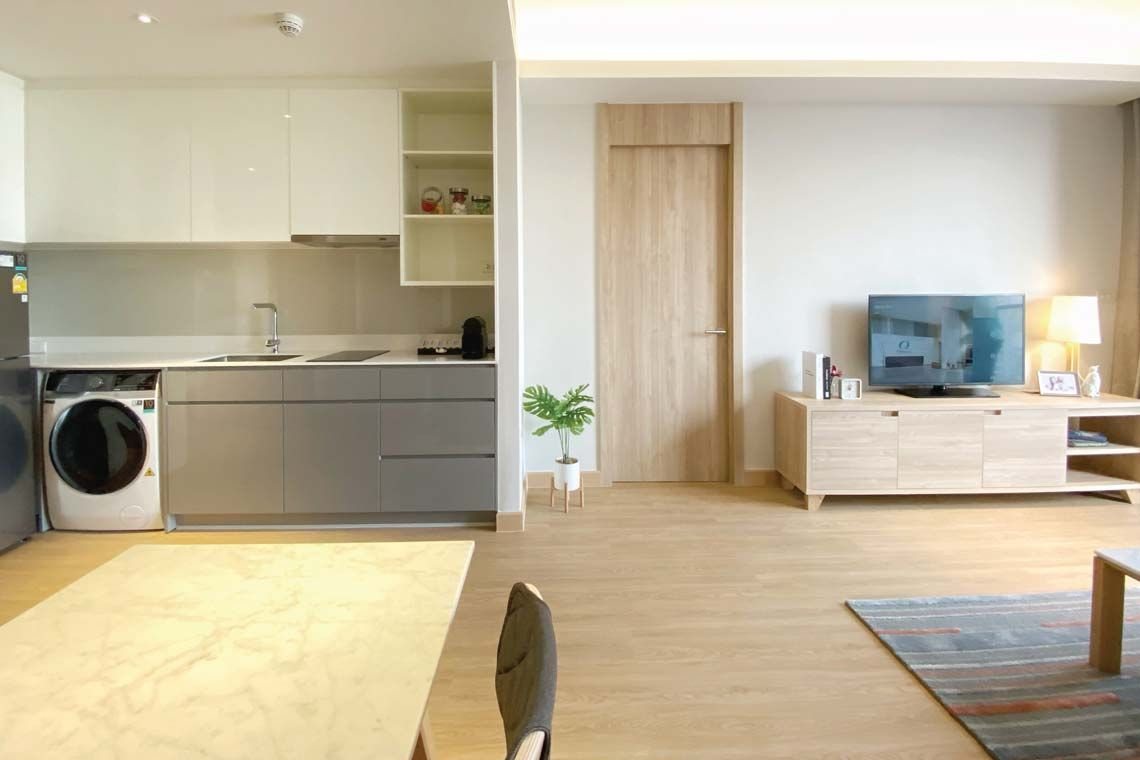 Oakwood Suites Bangkok's one-bedroom executive's kitchenette and living room