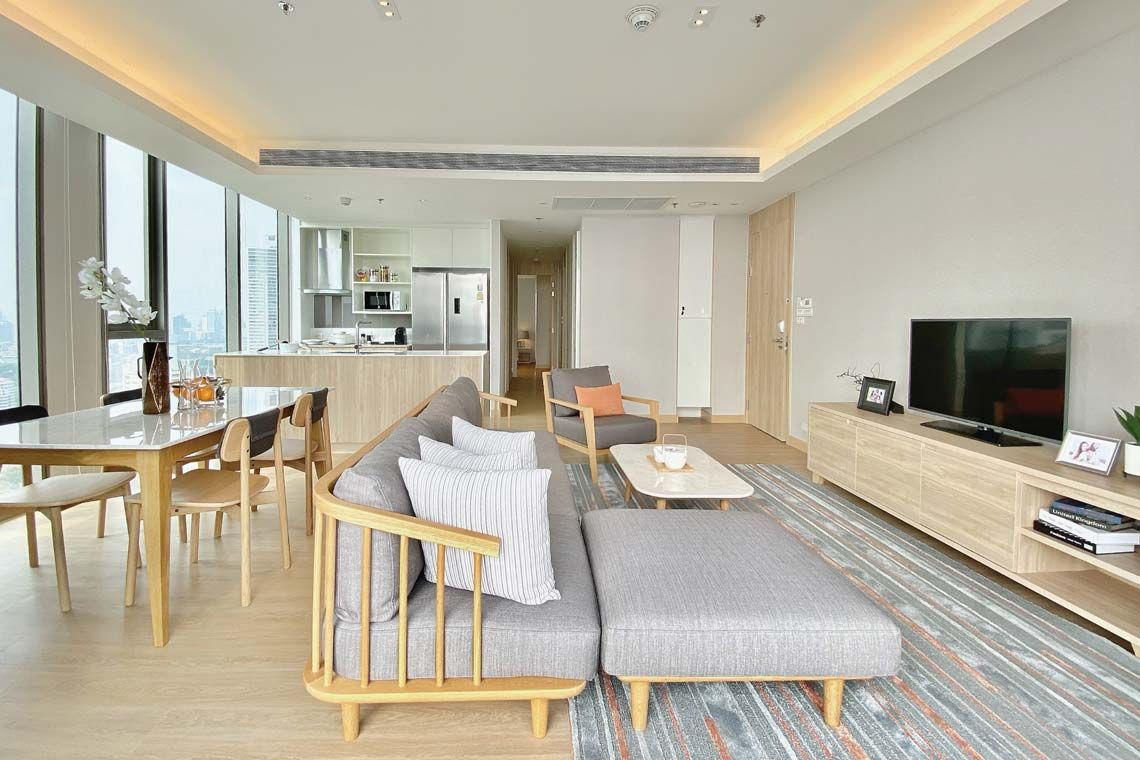 Oakwood Suites Bangkok's two-bedroom superior apartment's living room