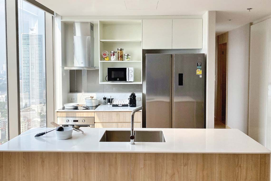 Oakwood Suites Bangkok's two-bedroom superior apartment's kitchenette