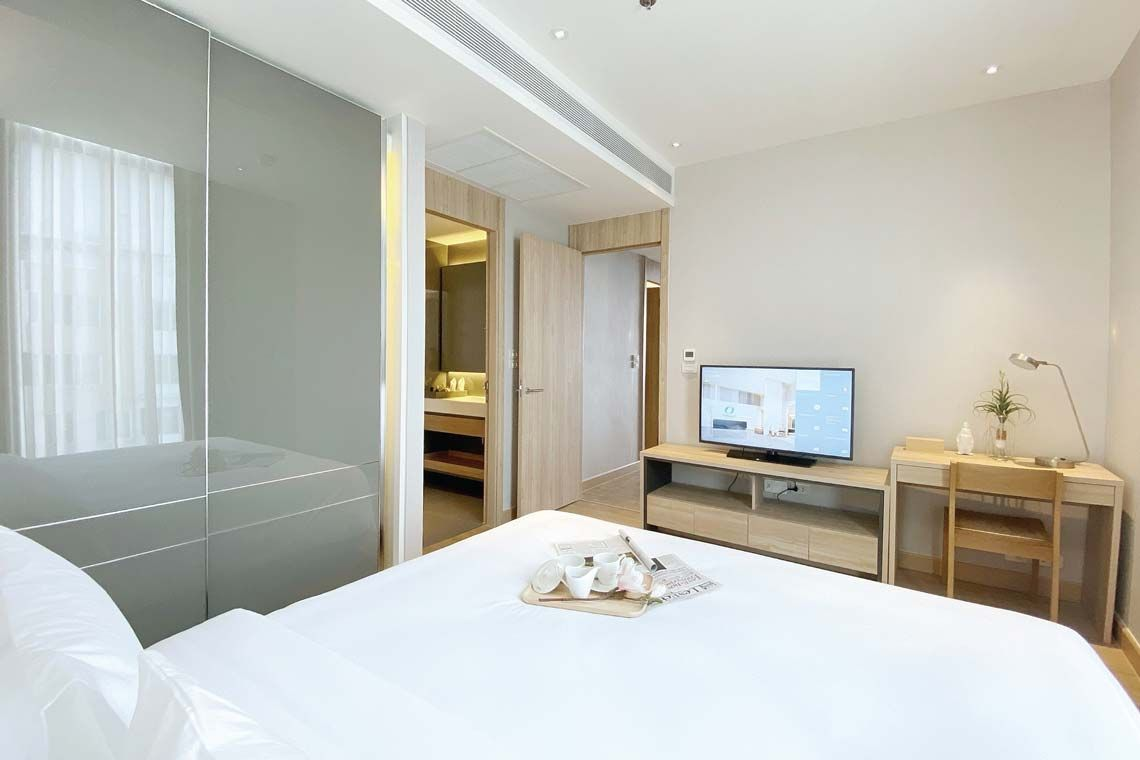 Oakwood Suites Bangkok's two-bedroom superior apartment's master bedroom