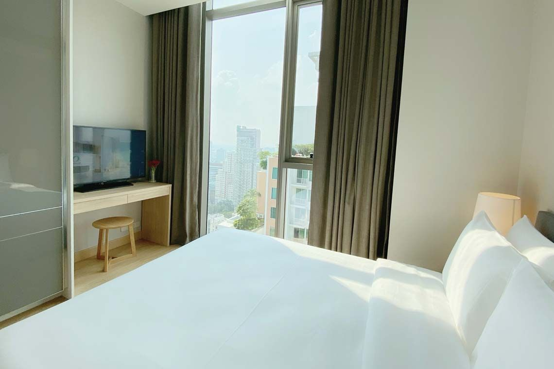 Oakwood Suites Bangkok's two-bedroom superior apartment's second bedroom