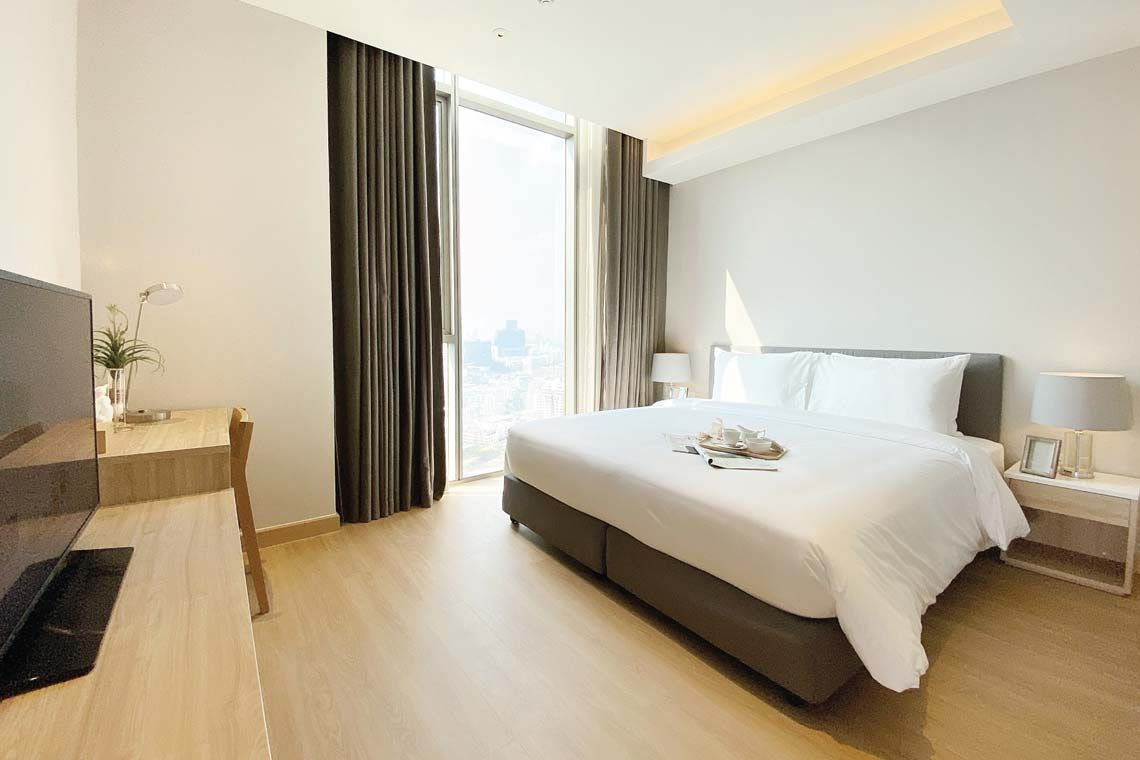 Oakwood Suites Bangkok's two-bedroom deluxe's master bedroom