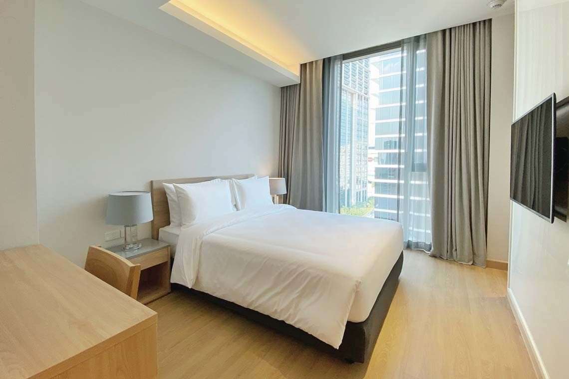 Oakwood Suites Bangkok's two-bedroom deluxe's second bedroom