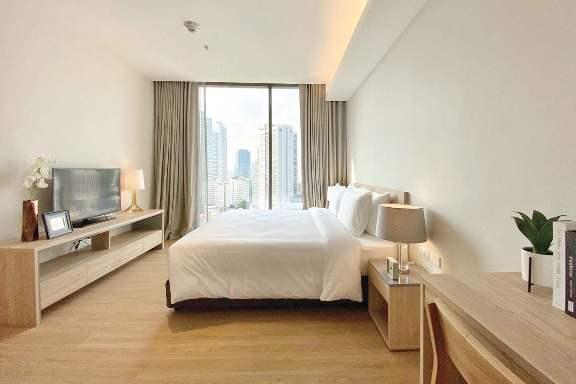 Oakwood Suites Bangkok's two-bedroom executive's master room
