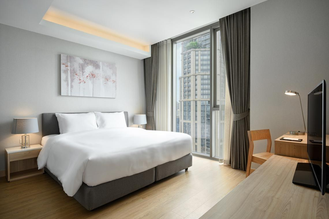Oakwood Suites Bangkok's two-bedroom superior apartment's bedroom