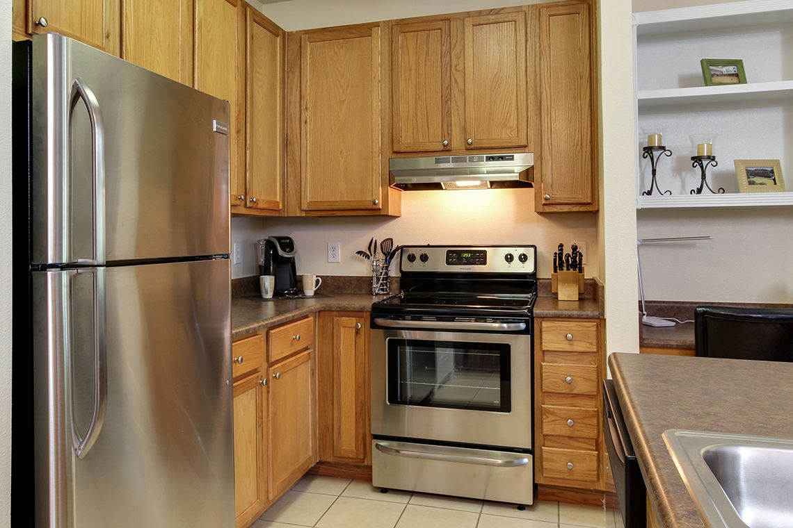 Oakwood Apartments Raleigh Brier Creek's one-bedroom apartment kitchen