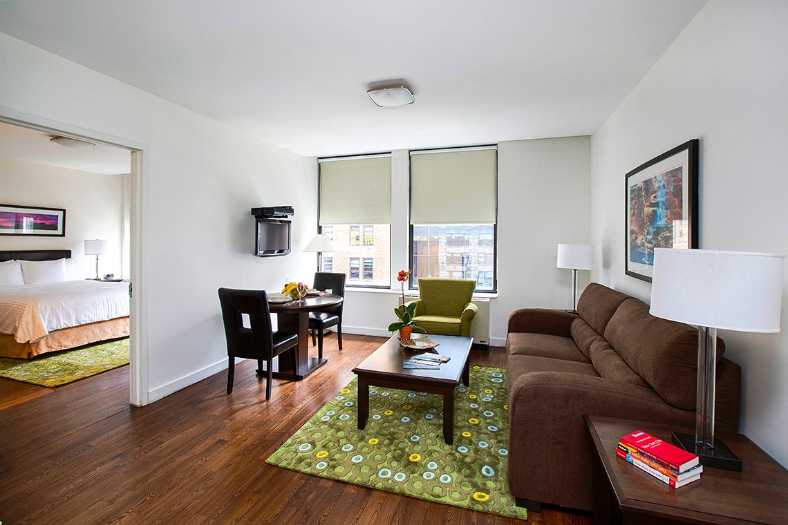 Oakwood Residence Sixth Avenue's one-bedroom apartment living room