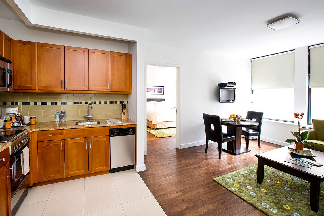 Oakwood Residence Sixth Avenue's one-bedroom apartment kitchen & dining room