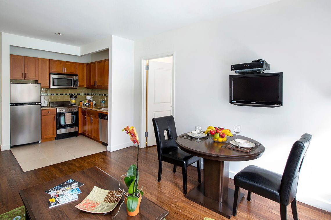Oakwood Residence Sixth Avenue's two-bedroom apartment living room & kitchen