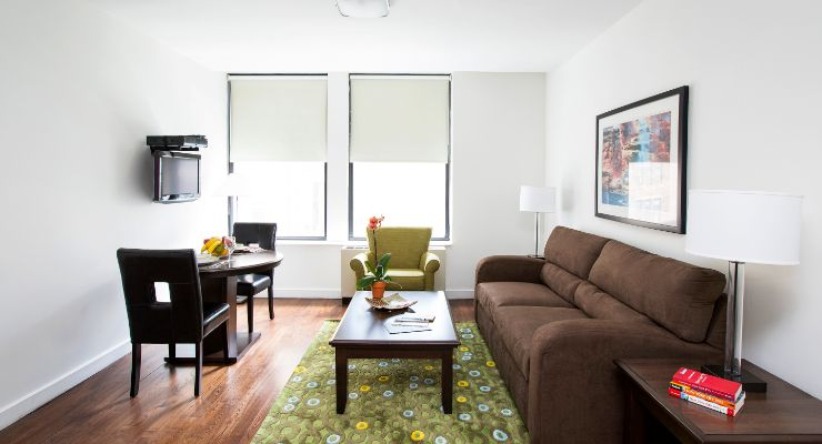 Oakwood Residence Sixth Avenue's two-bedroom apartment living room