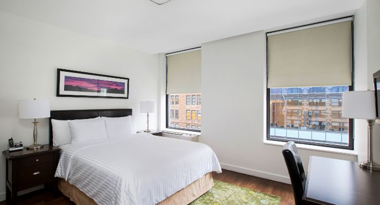Oakwood Residence Sixth Avenue's one-bedroom apartment bedroom