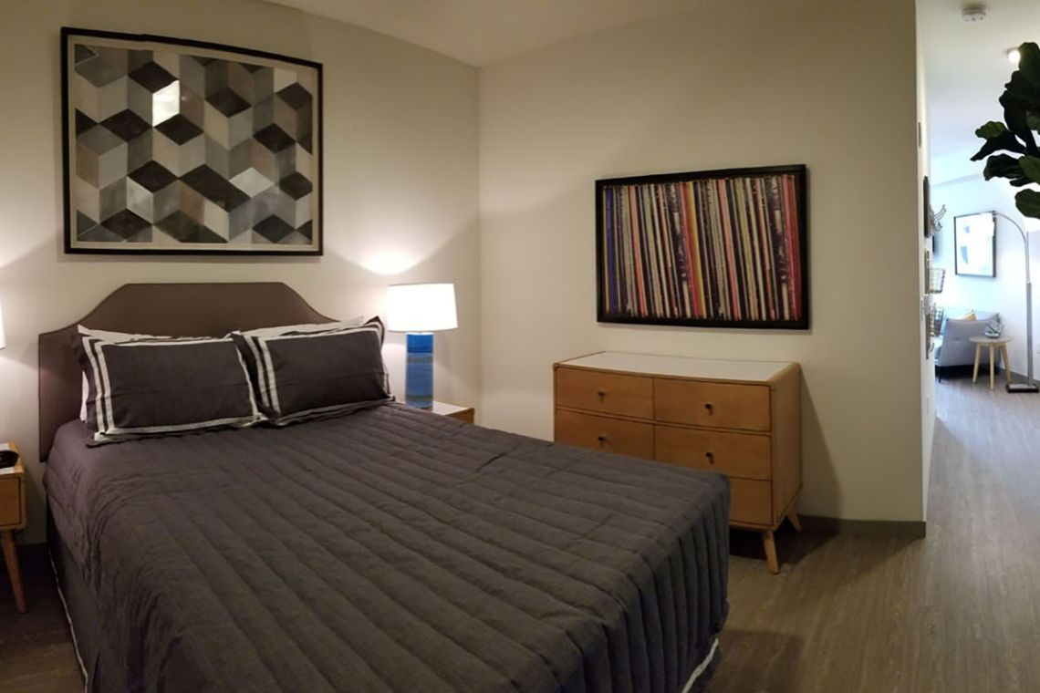 Lofts at the Junction's one-bedroom apartment bedroom
